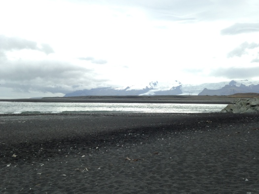 Some shots of the black sand beach directly across the street from Jökulsárlón. Seals hang out on the rocky shore and in the shallows, which are strewn with chunks of ice both small and large.